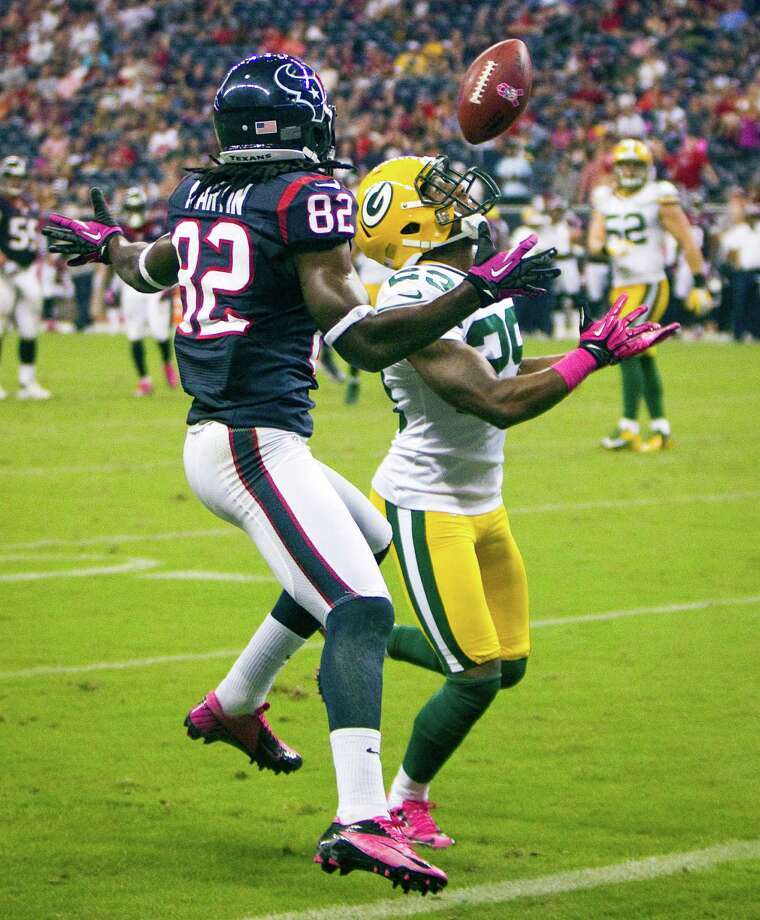 Packers cornerback Casey Hayward (29) intercepts a pass intended for Texans wide receiver Keshawn Martin (82) in the end zone during the fourth quarter. Photo: Brett Coomer, Houston Chronicle / © 2012  Houston Chronicle