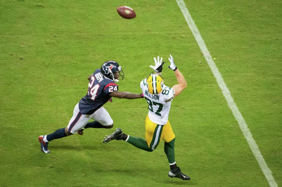 Packers wide receiver Jordy Nelson (87) beats Texans cornerback Johnathan Joseph (24) on a 41-yard pass for a touchdown from Aaron Rodgers during the first quarter. Photo: Smiley N. Pool, Houston Chronicle / © 2012  Houston Chronicle