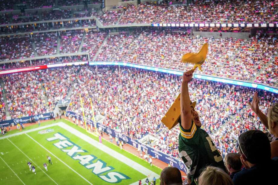Packers fans cheer a touchdown pass to Jordy Nelson on the opening drive against the Texans. Photo: Smiley N. Pool, Houston Chronicle / © 2012  Houston Chronicle