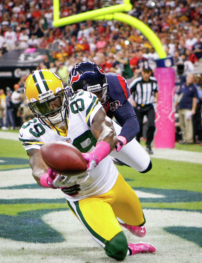 Packers wide receiver James Jones (89) catches a 6-yard touchdown pass as Texans free safety Danieal Manning (38) defends during the first quarter. Photo: Nick De La Torre, Houston Chronicle / © 2012  Houston Chronicle