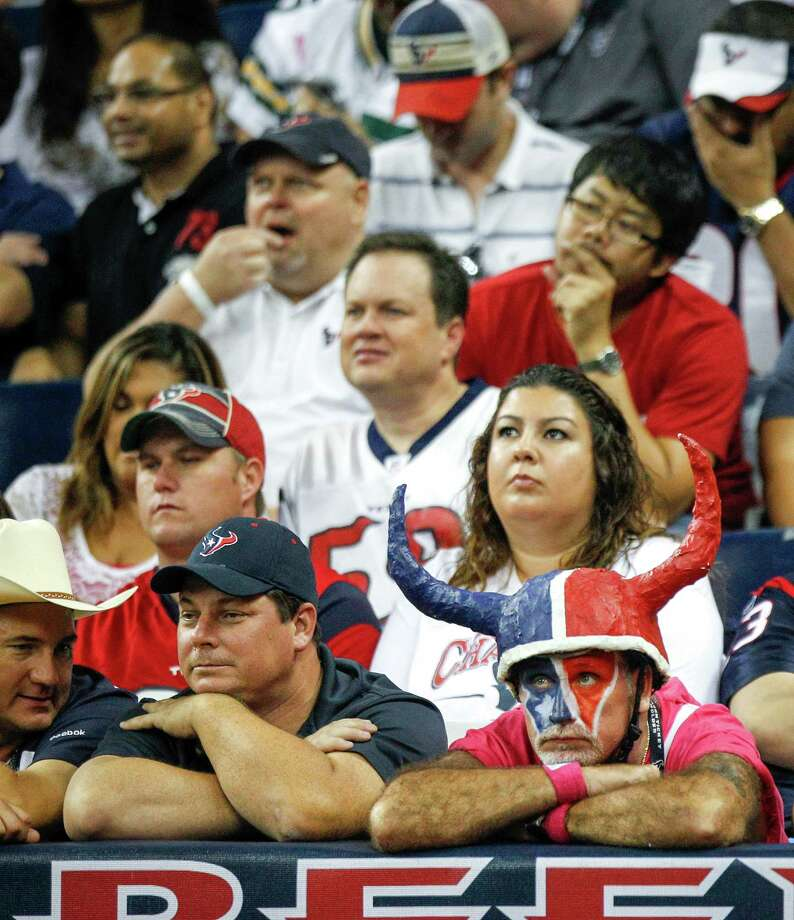Texans react after the Green Bay scored a touchdown during the second quarter. Photo: Brett Coomer, Houston Chronicle / © 2012  Houston Chronicle