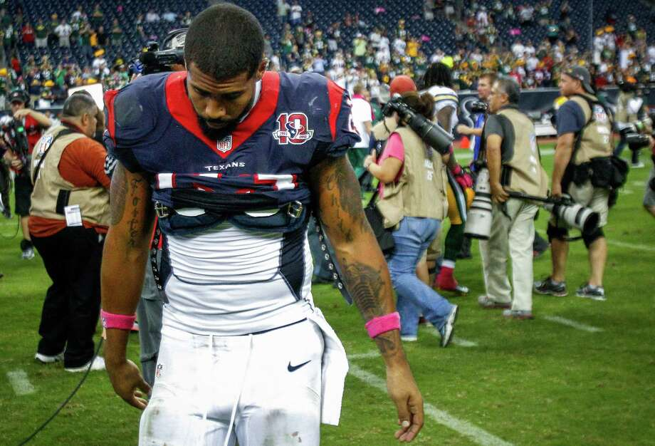 Texans running back Arian Foster walks off the field after the Texans lost to the Green Bay Packers. Photo: Brett Coomer, Houston Chronicle / © 2012  Houston Chronicle