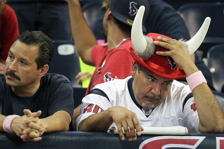 A Texans fan reacts during the fourth quarter. Photo: Karen Warren, Houston Chronicle / © 2012  Houston Chronicle
