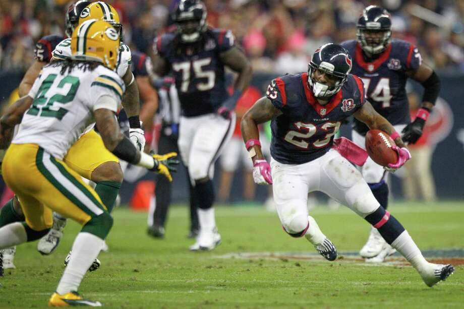 Texans running back Arian Foster (23) tries to cut around Packers free safety Morgan Burnett (42) during the second quarter. Photo: Brett Coomer, Houston Chronicle / © 2012  Houston Chronicle