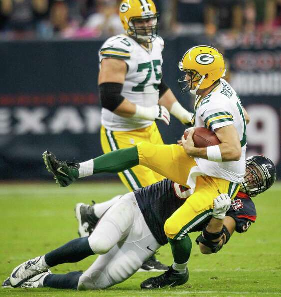 Texans defensive end J.J. Watt (99) sacks Packers quarterback Aaron Rodgers (12) during the first qu