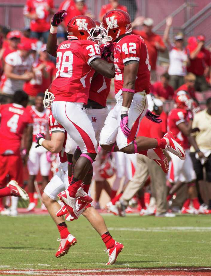 Houston linebacker George Bamfo (38), defensive back D.J. Hayden (2) and linebacker Phillip Steward (42) celebrate after a defensive stop against UAB during the first half of a college football game at Robertson Stadium, Saturday, Oct. 13, 2012, in Houston. Photo: Smiley N. Pool, Houston Chronicle / © 2012  Houston Chronicle