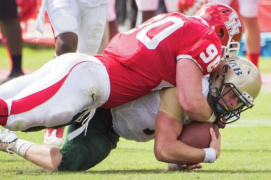 Houston defensive lineman Zeke Riser (90) sacks UAB quarterback Austin Brown (11) during the first half of a college football game at Robertson Stadium, Saturday, Oct. 13, 2012, in Houston. Photo: Smiley N. Pool, Houston Chronicle / © 2012  Houston Chronicle