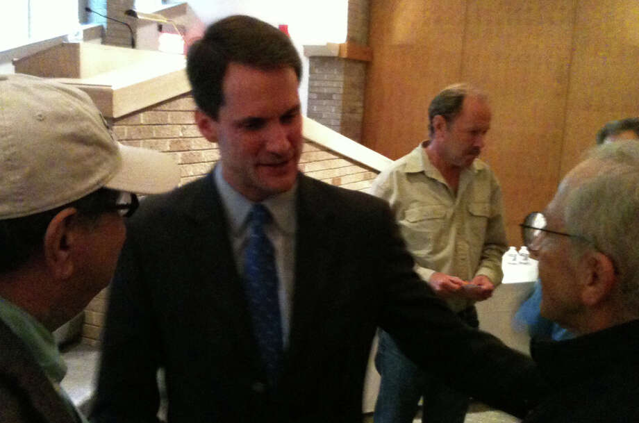 U.S. Rep. Jim Himes, a Democrat seeking election to a third term in the 4th Congressional District, talks with people who attended a forum Sunday afternoon at Temple Israel. Photo: Andrew Brophy / Westport News contributed