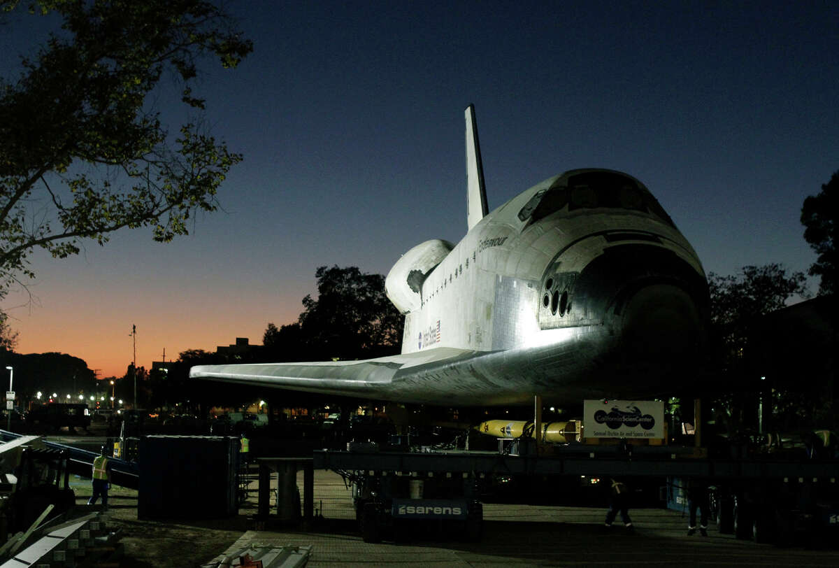 The space shuttle Endeavour is moved to the hangar in the California Science Center on Sunday, Oct. 14, 2012, in Los Angeles. Endeavour arrived at the museum after a 12-mile parade with thousands of onlookers ending with a greeting party of city leaders and other dignitaries. (AP Photo/Los Angeles Times, Lawrence K. Ho) NO FORNS; NO SALES; MAGS OUT; ORANGE COUNTY REGISTER OUT; LOS ANGELES DAILY NEWS OUT; VENTURA COUNTY STAR OUT; INLAND VALLEY DAILY BULLETIN OUT; MANDATORY CREDIT, TV OUT