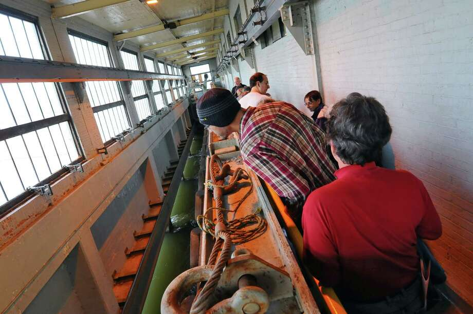 Visitors tour the intake area, where water enters the 6 megawatt Green Island Hydroelectric Plant, built in 1921 by Henry Ford and sons, during a public tour of the facility on Sunday Oct. 14, 2012 in Green Island, NY. (Philip Kamrass /  Times Union) Photo: Philip Kamrass / 00019638A