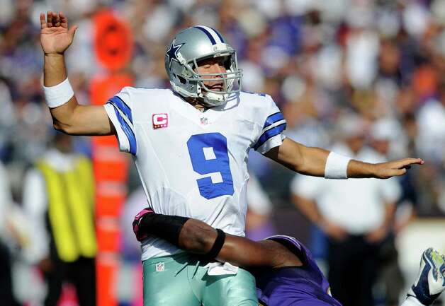 Dallas Cowboys quarterback Tony Romo reacts as he is tackled by Baltimore Ravens outside linebacker Courtney Upshaw in the second half of an NFL football game in Baltimore, Sunday, Oct. 14, 2012. (AP Photo/Nick Wass) Photo: Nick Wass, FRE / FR67404 AP