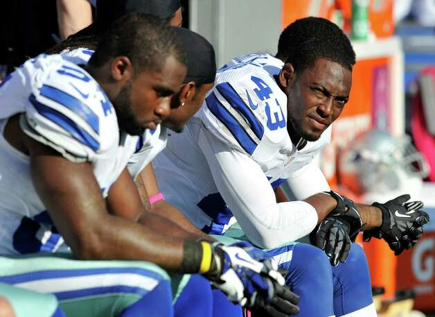 Dallas Cowboys safety Gerald Sensabaugh (43) looks on from the sideline in the second half of an NFL football game against the Baltimore Ravens in Baltimore, Sunday, Oct. 14, 2012. Baltimore won 31-29. (AP Photo/Gail Burton) Photo: Gail Burton, FRE / FR4095 AP