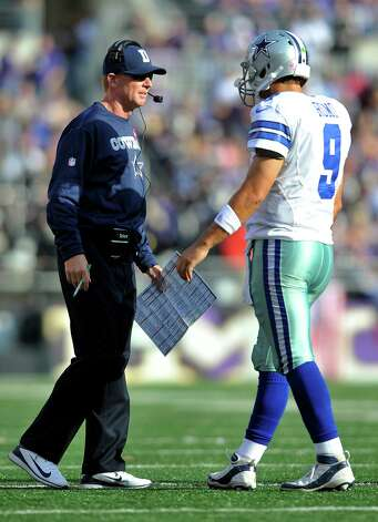 Dallas Cowboys head coach Jason Garrett, left, speaks with quarterback Tony Romo in the second half of an NFL football game against the Baltimore Ravens in Baltimore, Sunday, Oct. 14, 2012. (AP Photo/Gail Burton) Photo: Gail Burton, FRE / FR4095 AP