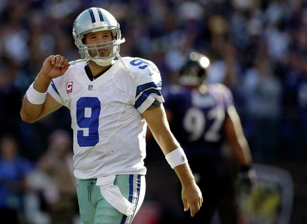 Dallas Cowboys quarterback Tony Romo walks off the field after a failed two-point conversion attempt in the second half of an NFL football game against the Baltimore Ravens in Baltimore, Sunday, Oct. 14, 2012. Baltimore won 31-29. (AP Photo/Patrick Semansky) Photo: Patrick Semansky, STF / AP