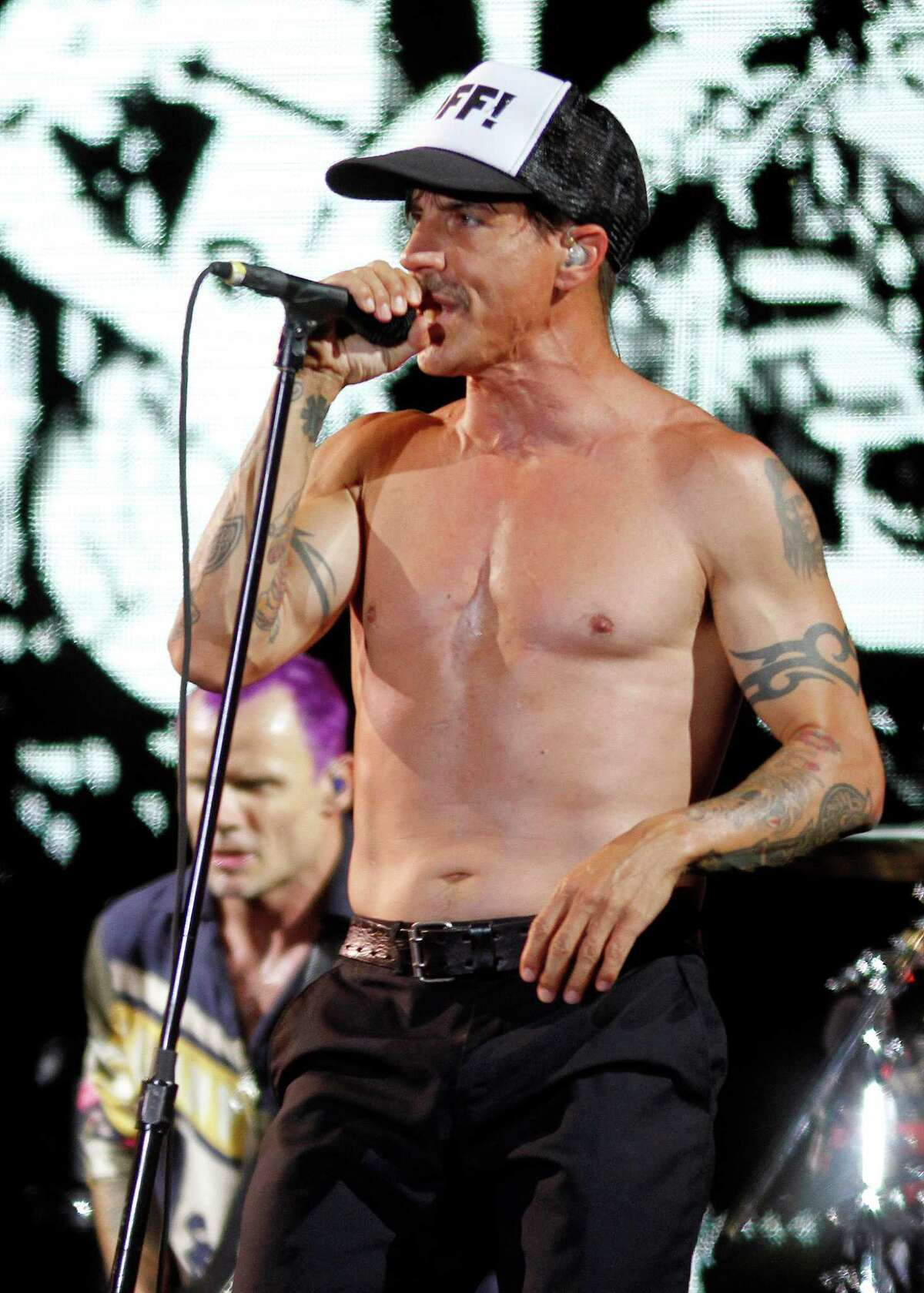 The Red Hot Chili Peppers perform at the Austin City Limits Music Festival, Sunday, Oct. 14, 2012, in Austin, Texas.(Photo by Jack Plunkett/Invision/AP)