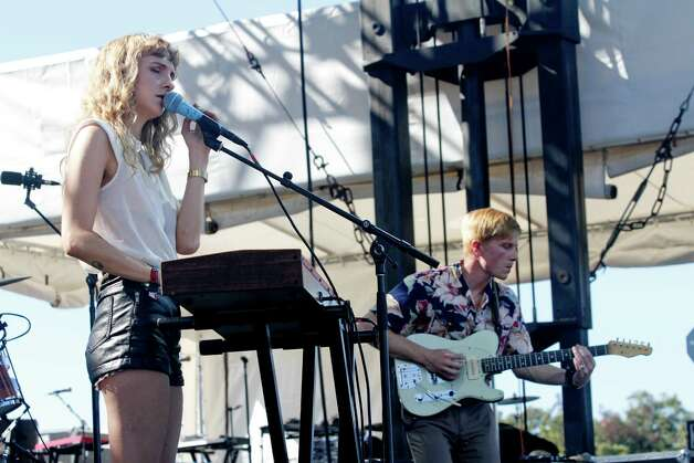 Alaina Moore and Patrick Riley of Tennis performs at the Austin City Limits Music Festival, Sunday, Oct. 14, 2012, in Austin, Texas. (Photo by Jack Plunkett/Invision/AP) Photo: Jack Plunkett, Associated Press / Invision
