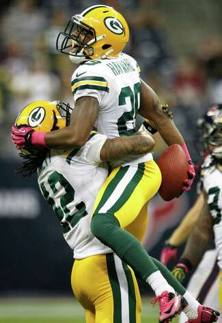 Packers cornerback Casey Hayward (29) celebrates his interception of a pass by Houston Texans quarterback T.J. Yates during the fourth quarter. Photo: Brett Coomer, Staff / © 2012  Houston Chronicle