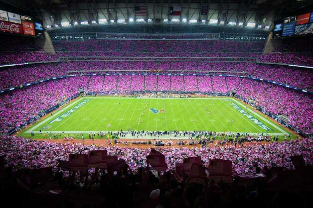 Fans paint the stadium pink with poster cards in recognition of Breast Cancer Awareness during the opening kickoff of the Green Bay Packers game against the Houston Texans at Reliant Stadium. Photo: Smiley N. Pool, Staff / © 2012  Houston Chronicle