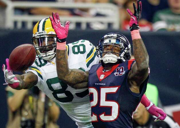 Green Bay Packers wide receiver James Jones (89) catches a touchdown pass as Houston Texans cornerback Kareem Jackson (25) defends during the fourth quarter at Reliant Stadium on Sunday, Oct. 14, 2012, in Houston. Photo: Brett Coomer, Staff / © 2012  Houston Chronicle