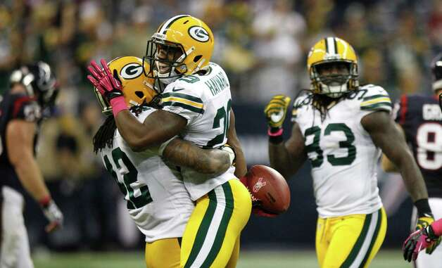 Green Bay Packers cornerback Casey Hayward (29) celebrates his interception of a pass by Houston Texans quarterback T.J. Yates during the fourth quarter at Reliant Stadium on Sunday, Oct. 14, 2012, in Houston. The Packers beat the Texans 42-24. ( Brett Coomer / Houston Chronicle ) Photo: Brett Coomer, Staff / © 2012  Houston Chronicle