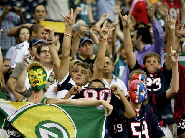 Green Bay Packers fans cheer during the fourth quarter during the Packers game against the Houston Texans at Reliant Stadium on Sunday, Oct. 14, 2012, in Houston. The Packers beat the Texans 42-24. ( Brett Coomer / Houston Chronicle ) Photo: Brett Coomer, Staff / © 2012  Houston Chronicle