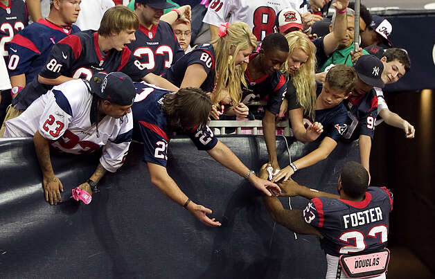 Houston Texans running back Arian Foster (23) greets fans after the game on his way to the locker room at Reliant Stadium on Sunday, Oct. 14, 2012, in Houston. 42-24. ( Karen Warren / Houston Chronicle ) Photo: Karen Warren, Staff / © 2012  Houston Chronicle