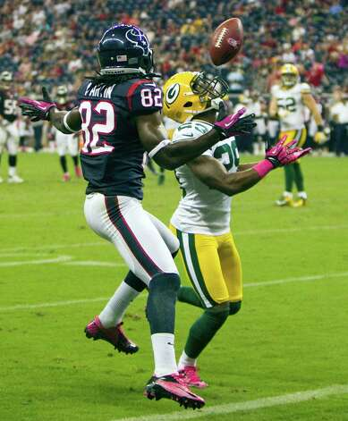 Green Bay Packers cornerback Casey Hayward (29) intercepts a pass intended for Houston Texans wide receiver Keshawn Martin (82) in the end zone during the fourth quarter at Reliant Stadium on Sunday, Oct. 14, 2012, in Houston. ( Brett Coomer / Houston Chronicle ) Photo: Brett Coomer, Staff / © 2012  Houston Chronicle