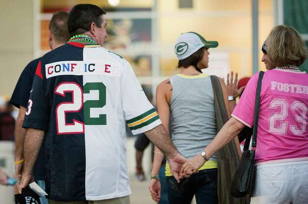 "A fan wears a jersey made of a Houston Texans and Green Bay Packers jersey sewn together with the word ""conflicted"" written across the back as he arrives at Reliant Stadium for the Packers game against the Texans on Sunday, Oct. 14, 2012, in Houston. ( Smiley N. Pool / Houston Chronicle ) Photo: Smiley N. Pool, Staff / © 2012  Houston Chronicle"