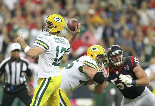 Green Bay Packers quarterback Aaron Rodgers (12) gets protection as he throws a pass during the third quarter against the Houston Texans at Reliant Stadium on Sunday, Oct. 14, 2012, in Houston. ( Karen Warren / Houston Chronicle ) Photo: Karen Warren, Staff / © 2012  Houston Chronicle
