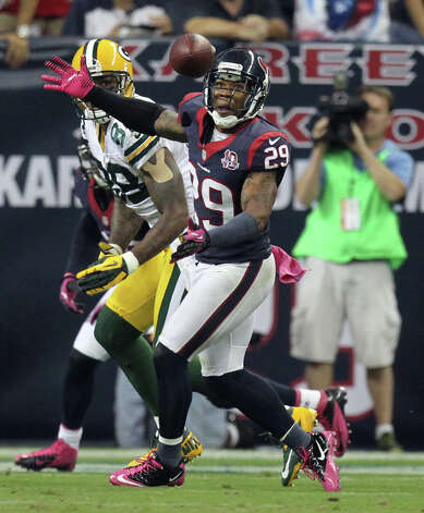 Houston Texans strong safety Glover Quin (29) breaks up a pass intended for Green Bay Packers wide receiver James Jones (89) during the third quarter at Reliant Stadium, Sunday, Oct. 14, 2012, in Houston.  ( Nick de la Torre / Houston Chronicle ) Photo: Nick De La Torre, Staff / © 2012  Houston Chronicle