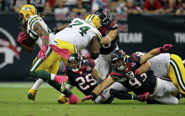 Green Bay Packers running back Alex Green (20) gets past Houston Texans strong safety Glover Quin (29) and defensive end Jared Crick (93) during the third quarter at Reliant Stadium, Sunday, Oct. 14, 2012, in Houston.  ( Nick de la Torre / Houston Chronicle ) Photo: Nick De La Torre, Staff / © 2012  Houston Chronicle
