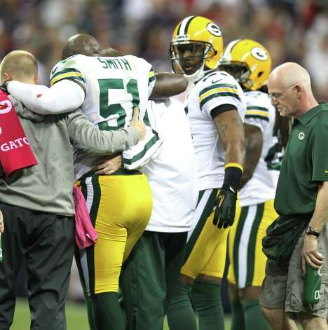 Green Bay Packers inside linebacker D.J. Smith (51) leaves the game after being injured during the second quarter against the Houston Texans at Reliant Stadium on Sunday, Oct. 14, 2012, in Houston. ( Karen Warren / Houston Chronicle ) Photo: Karen Warren, Staff / © 2012  Houston Chronicle