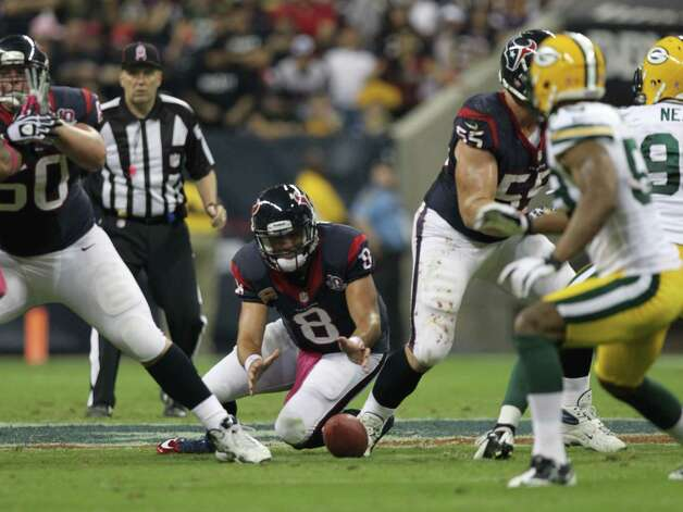Houston Texans quarterback Matt Schaub (8) dives on his own fumble during the second quarter against the Green Bay Packers at Reliant Stadium, Sunday, Oct. 14, 2012, in Houston.  ( Nick de la Torre / Houston Chronicle ) Photo: Nick De La Torre, Staff / © 2012  Houston Chronicle