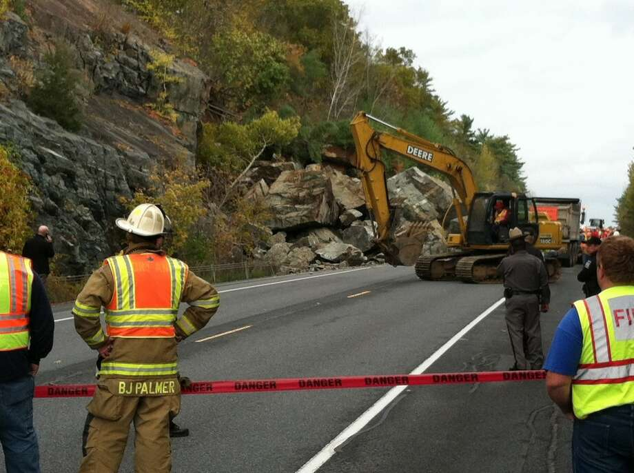 Emergency workers respond to a massive rock slide Monday morning on Route 4 in Fort Ann. (Skip Dickstein / Times Union)