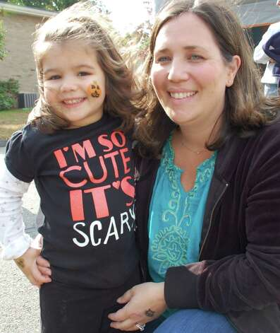 "Isabelle Nappi, 3, of Fairfield, with her mom, Jessica, at the Assumption Scarecrow Festival on Sunday. Her shirt says it all: ""I'm so cute it's Scary!"" Photo: Jarret Liotta / Fairfield Citizen contributed"