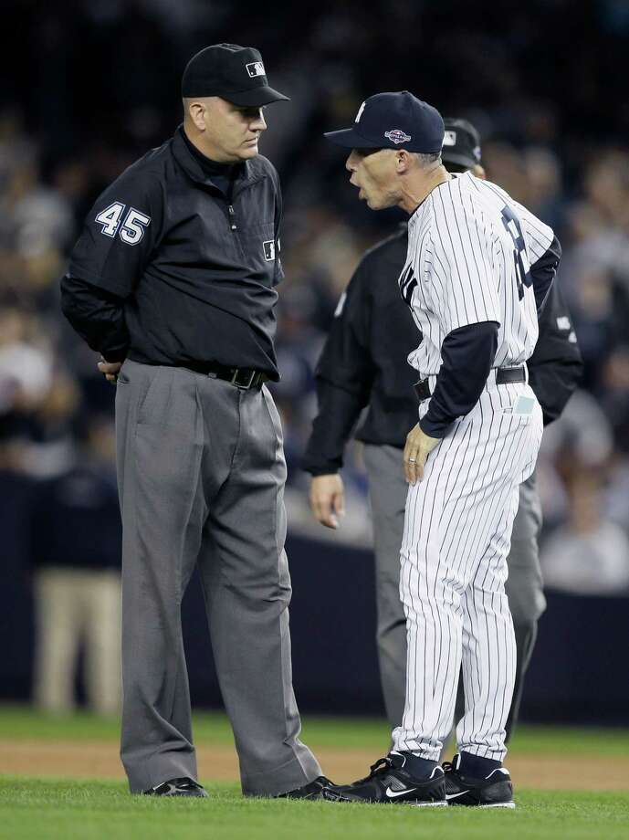 New York Yankees manager Joe Girardi argues with umpire Jeff Nelson in the eighth inning of Game 2 of the American League championship series against the Detroit Tigers Sunday, Oct. 14, 2012, in New York. Photo: Matt Slocum, AP / AP
