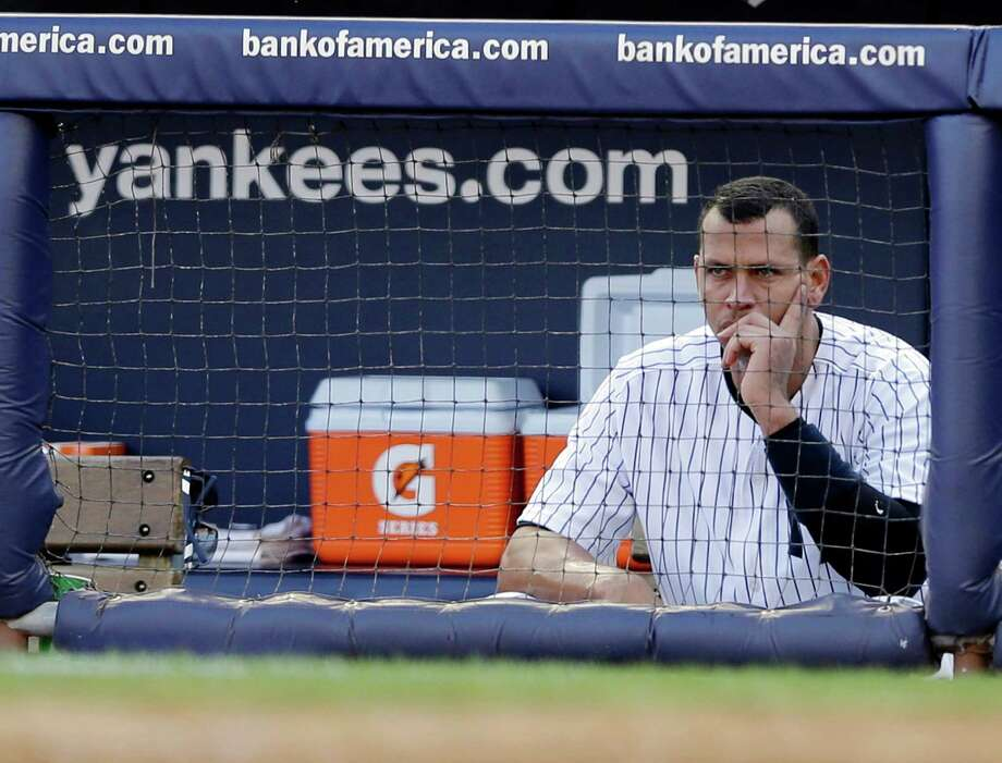 New York Yankees' Alex Rodriguez sits in the dugout after striking out in the second inning of Game 2 of the American League championship series against the Detroit Tigers on Sunday, Oct. 14, 2012, in New York. Photo: Matt Slocum, AP / AP