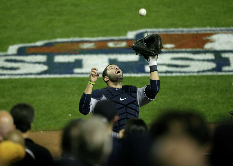 Detroit Tigers catcher Alex Avila catches a foul ball by New York Yankees' Mark Teixeira for the final out in the eighth inning in Game 2 of the American League championship series Sunday, Oct. 14, 2012, in New York. Photo: Kathy Willens, AP / AP