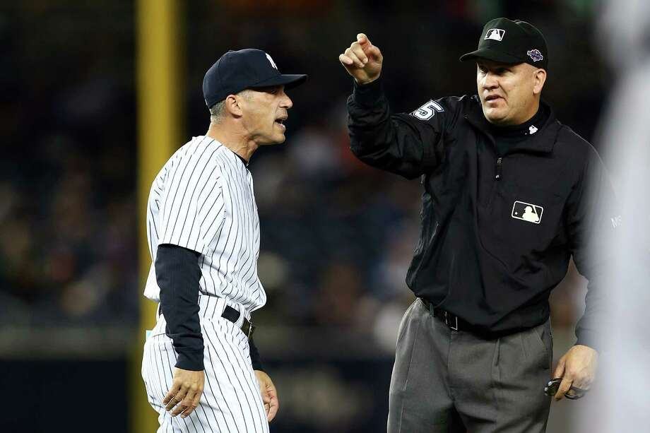 NEW YORK, NY - OCTOBER 14:  Manager Joe Girardi of the New York Yankees is thrown out of the game by umpire Jeff Nelson out of the game in the eighth inning against the Detroit Tigers during Game Two of the American League Championship Series at Yankee Stadium on October 14, 2012 in the Bronx borough of New York City. Photo: Elsa, Getty Images / 2012 Getty Images
