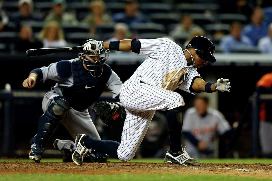 NEW YORK, NY - OCTOBER 14:  Curtis Granderson #14 of the New York Yankees strikes out for the final out of the game against the Detroit Tigers during Game Two of the American League Championship Series at Yankee Stadium on October 14, 2012 in the Bronx borough of New York City. Photo: Elsa, Getty Images / 2012 Getty Images