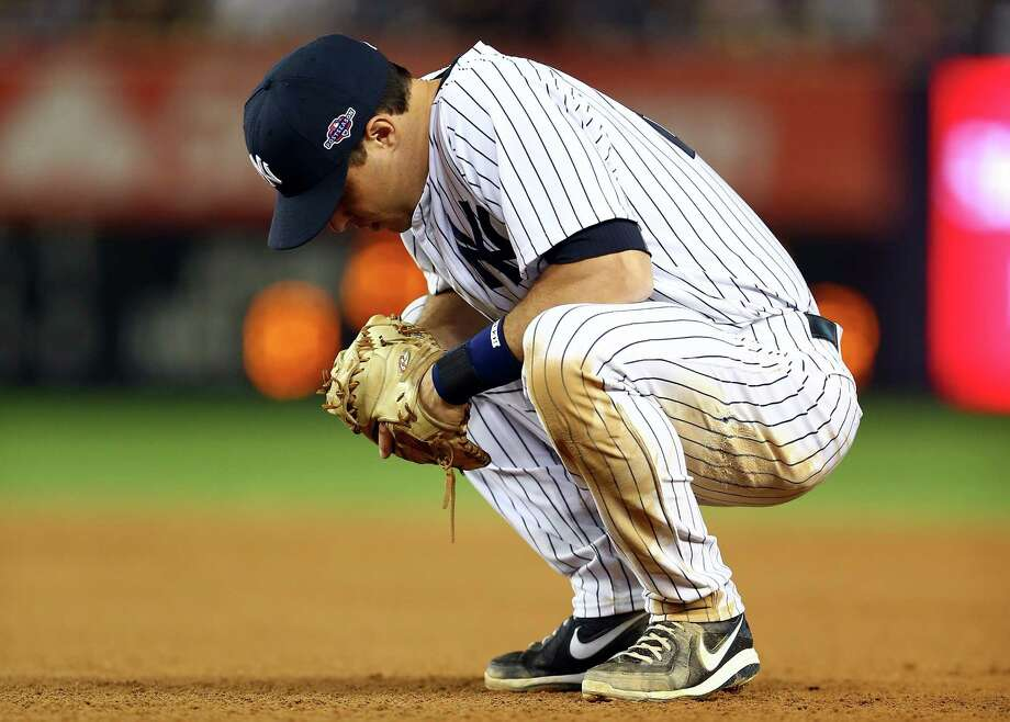 NEW YORK, NY - OCTOBER 14:  Mark Teixeira #25 of the New York Yankees looks on dejected against the Detroit Tigers during Game Two of the American League Championship Series at Yankee Stadium on October 14, 2012 in the Bronx borough of New York City. Photo: Elsa, Getty Images / 2012 Getty Images