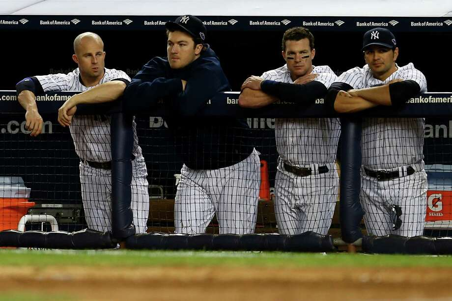 NEW YORK, NY - OCTOBER 14:  The New York Yankees look on dejected against the Detroit Tigers during Game Two of the American League Championship Series at Yankee Stadium on October 14, 2012 in the Bronx borough of New York City. Photo: Alex Trautwig, Getty Images / 2012 Getty Images