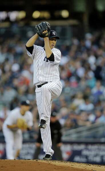 New York Yankees' Hiroki Kuroda throws in the fifth inning of Game 2 of the American League champion
