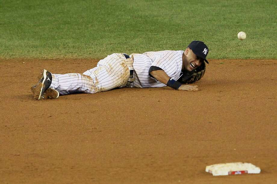 NEW YORK, NY - OCTOBER 13:  Derek Jeter #2 of the New York Yankees reacts after he injured his leg in the top of the 12th inning against the Detroit Tigers during Game One of the American League Championship Series at Yankee Stadium on October 13, 2012 in the Bronx borough of New York City, New York. Photo: Alex Trautwig, Getty Images / 2012 Getty Images