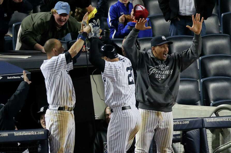 NEW YORK, NY - OCTOBER 13:  (L-R) Derek Jeter #2 , Raul Ibanez #27 and Alex Rodriguez #13 of the New