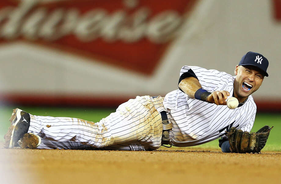 NEW YORK, NY - OCTOBER 13:  Derek Jeter #2 of the New York Yankees reacts after he injured his leg in the top of the 12th inning against the Detroit Tigers during Game One of the American League Championship Series at Yankee Stadium on October 13, 2012 in the Bronx borough of New York City, New York. Photo: Al Bello, Getty Images / 2012 Getty Images