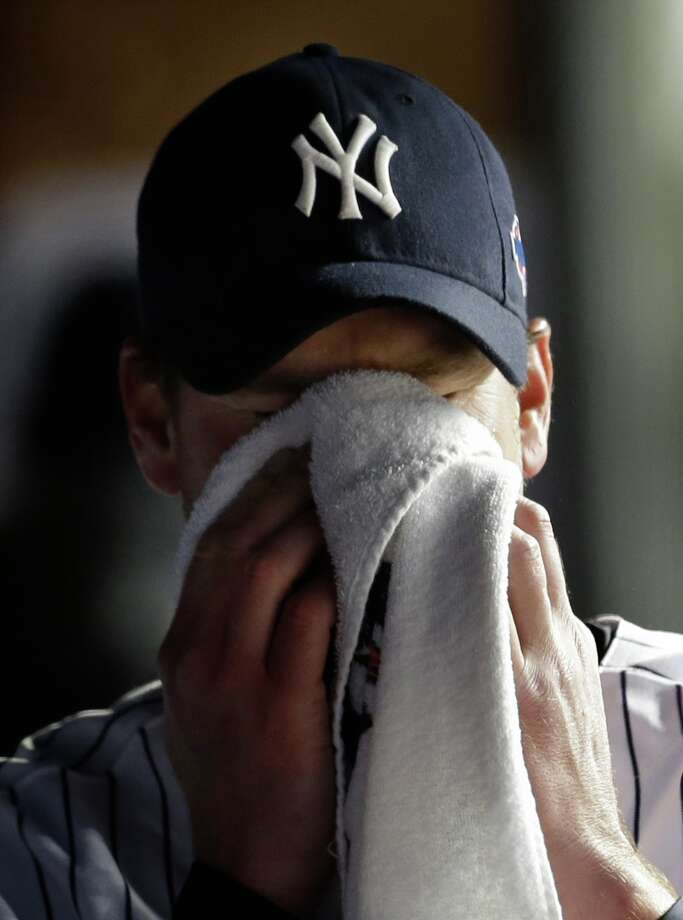 New York Yankees relief pitcher Derek Lowe wipes his face after leaving the game in the eighth inning during Game 1 of the American League championship series against the Detroit Tigers Saturday, Oct. 13, 2012, in New York. Photo: Paul Sancya, AP / AP
