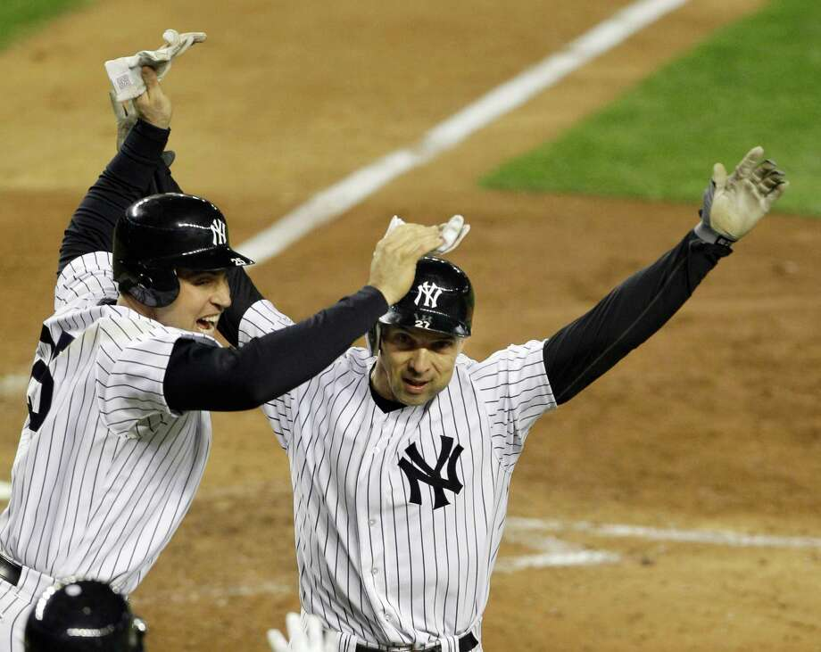 New York Yankees Raul Ibanez, right, and  Mark Teixeira celebrate after Ibanez hit a two-run home run in Game 1 of the American League championship series against the Detroit Tigers Saturday, Oct. 13, 2012, in New York. Photo: Kathy Willens, AP / AP