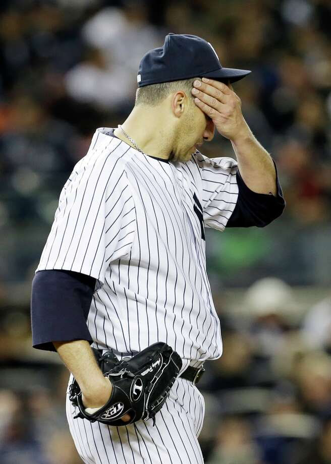 New York Yankees' Andy Pettitte wipes his brow during the sixth inning in Game 1 of the American League championship series against the Detroit Tigers Saturday, Oct. 13, 2012, in New York. Photo: Paul Sancya, AP / AP