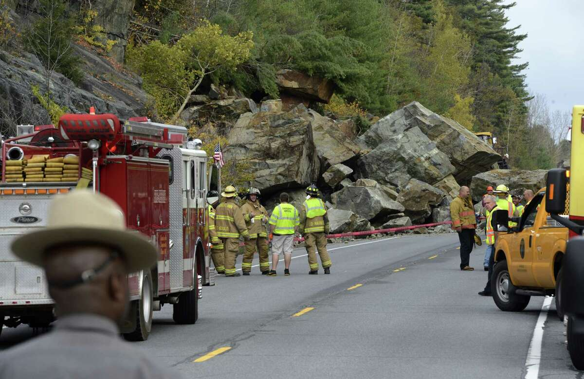 A large rock slide Monday morning has closed State Route 4 north of Fort Ann. Numerous pieces of heavy excavation equipment have been brought to the scene to determine if there were any vehicles caught under the rocks. (Skip Dickstein / Times Union)
